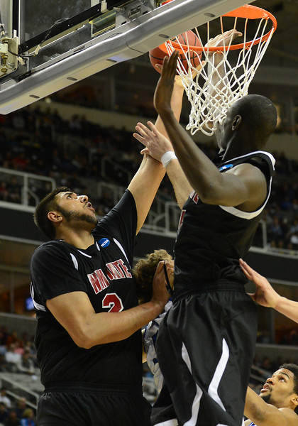 March 21, 2013: New Mexico State Aggies center Sim Bhullar (2) tries to tip in a missed shot during a game between the New Mexico State Aggies and the Saint Louis Billikens in the second round of the NCAA Division I Men's Basketball Championship at HP Pavilion in San Jose, California.