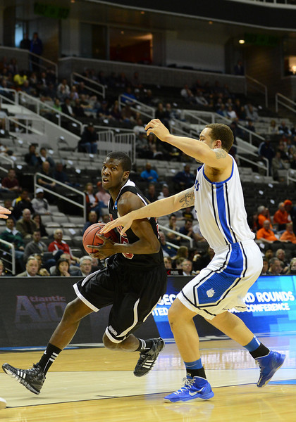 March 21, 2013: New Mexico State Aggies forward Renaldo Dixon (25) tries to drive past Saint Louis Billikens forward Grandy Glaze (1) during a game between the New Mexico State Aggies and the Saint Louis Billikens in the second round of the NCAA Division I Men's Basketball Championship at HP Pavilion in San Jose, California.
