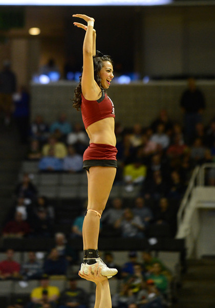 March 21, 2013: An New Mexico State Aggies cheerleader performs in a timeout during a game between the New Mexico State Aggies and the Saint Louis Billikens in the second round of the NCAA Division I Men's Basketball Championship at HP Pavilion in San Jose, California.