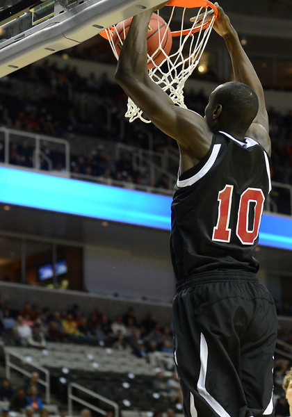 March 21, 2013: New Mexico State Aggies forward Bandja Sy (10) dunks during a game between the New Mexico State Aggies and the Saint Louis Billikens in the second round of the NCAA Division I Men's Basketball Championship at HP Pavilion in San Jose, California.