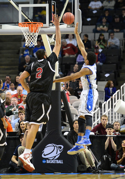 March 21, 2013: New Mexico State Aggies center Sim Bhullar (2) tries to block a shot during a game between the New Mexico State Aggies and the Saint Louis Billikens in the second round of the NCAA Division I Men's Basketball Championship at HP Pavilion in San Jose, California.