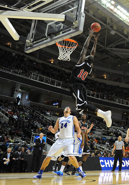 March 21, 2013: New Mexico State Aggies forward Bandja Sy (10) tries to grab a lob pass during a game between the New Mexico State Aggies and the Saint Louis Billikens in the second round of the NCAA Division I Men's Basketball Championship at HP Pavilion in San Jose, California.