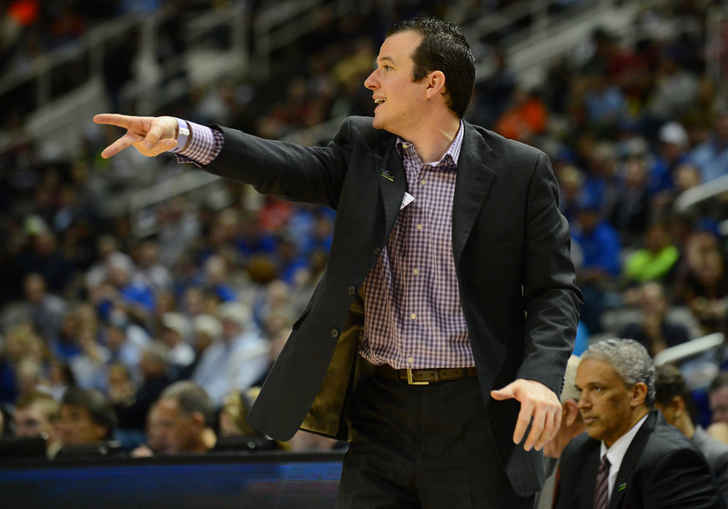 March 21, 2013: New Mexico State Aggies associate head coach Paul Weir shouts instructions to his team during a game between the New Mexico State Aggies and the Saint Louis Billikens in the second round of the NCAA Division I Men's Basketball Championship at HP Pavilion in San Jose, California.