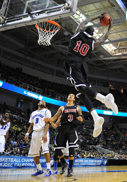 March 21, 2013: New Mexico State Aggies forward Bandja Sy (10) grabs an alley-oop pass during a game between the New Mexico State Aggies and the Saint Louis Billikens in the second round of the NCAA Division I Men's Basketball Championship at HP Pavilion in San Jose, California.
