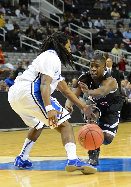 March 21, 2013: New Mexico State Aggies guard K.C. Ross-Miller (12) throws an entry pass during a game between the New Mexico State Aggies and the Saint Louis Billikens in the second round of the NCAA Division I Men's Basketball Championship at HP Pavilion in San Jose, California.