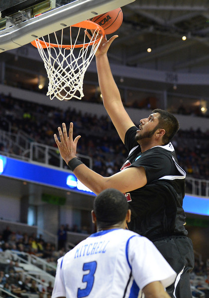 March 21, 2013: New Mexico State Aggies center Sim Bhullar (2) lays the ball in the basket during a game between the New Mexico State Aggies and the Saint Louis Billikens in the second round of the NCAA Division I Men's Basketball Championship at HP Pavilion in San Jose, California.