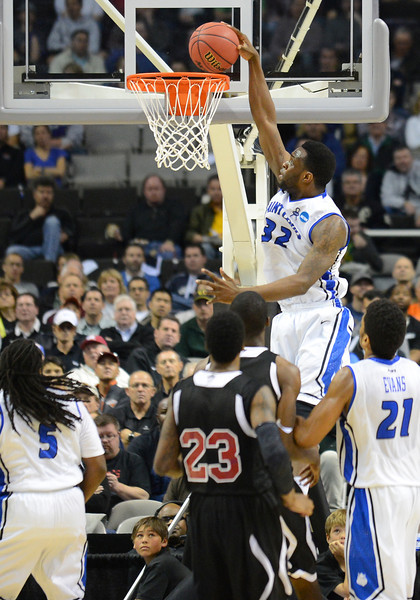 March 21, 2013: Saint Louis Billikens forward Cory Remekun (32) dunks during a game between the New Mexico State Aggies and the Saint Louis Billikens in the second round of the NCAA Division I Men's Basketball Championship at HP Pavilion in San Jose, California.