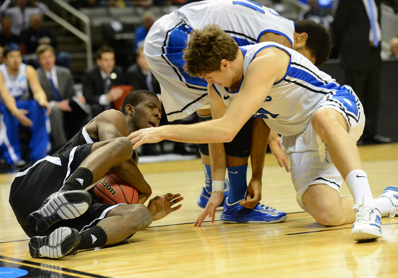 March 21, 2013: New Mexico State Aggies forward Renaldo Dixon (25) grabs a loose ball during a game between the New Mexico State Aggies and the Saint Louis Billikens in the second round of the NCAA Division I Men's Basketball Championship at HP Pavilion in San Jose, California.