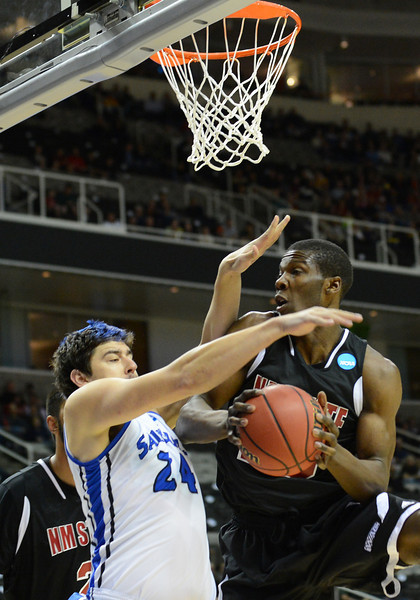 March 21, 2013: New Mexico State Aggies forward Renaldo Dixon (25) grabs a rebound during a game between the New Mexico State Aggies and the Saint Louis Billikens in the second round of the NCAA Division I Men's Basketball Championship at HP Pavilion in San Jose, California.