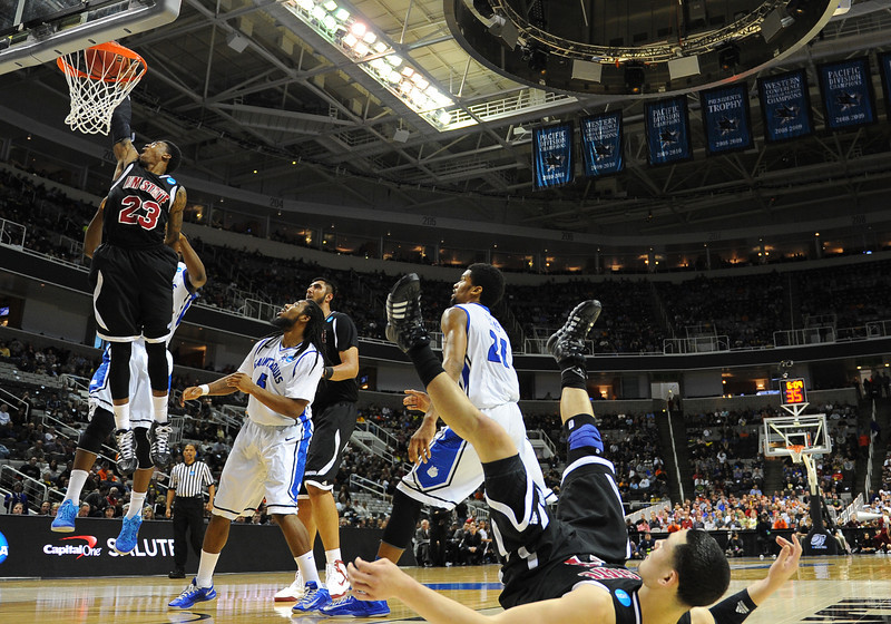 March 21, 2013: New Mexico State Aggies guard Daniel Mullings (23) dunks during a game between the New Mexico State Aggies and the Saint Louis Billikens in the second round of the NCAA Division I Men's Basketball Championship at HP Pavilion in San Jose, California.