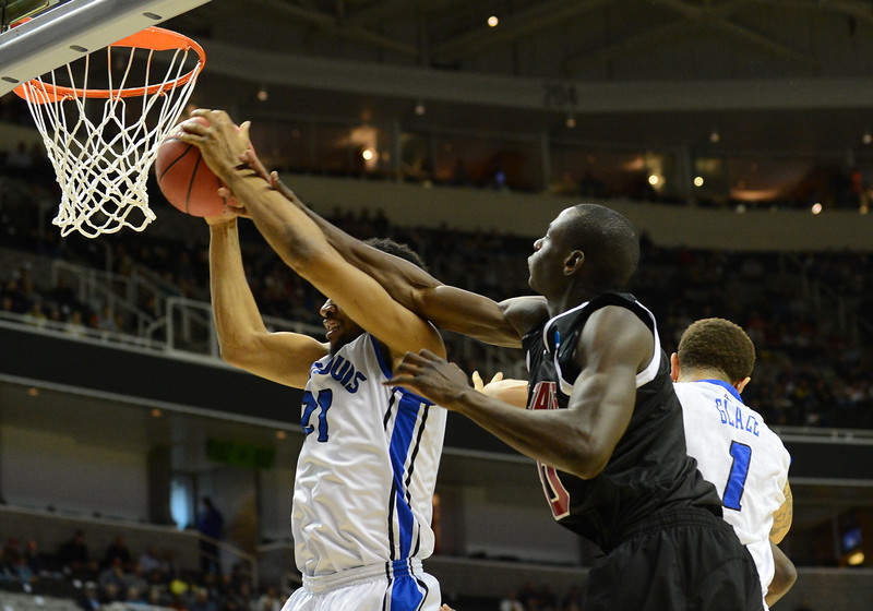March 21, 2013: Saint Louis Billikens forward Dwayne Evans (21) battles New Mexico State Aggies forward Bandja Sy (10) for a rebound during a game between the New Mexico State Aggies and the Saint Louis Billikens in the second round of the NCAA Division I Men's Basketball Championship at HP Pavilion in San Jose, California.