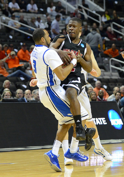 March 21, 2013: New Mexico State Aggies guard K.C. Ross-Miller (12) is tied up during a game between the New Mexico State Aggies and the Saint Louis Billikens in the second round of the NCAA Division I Men's Basketball Championship at HP Pavilion in San Jose, California.