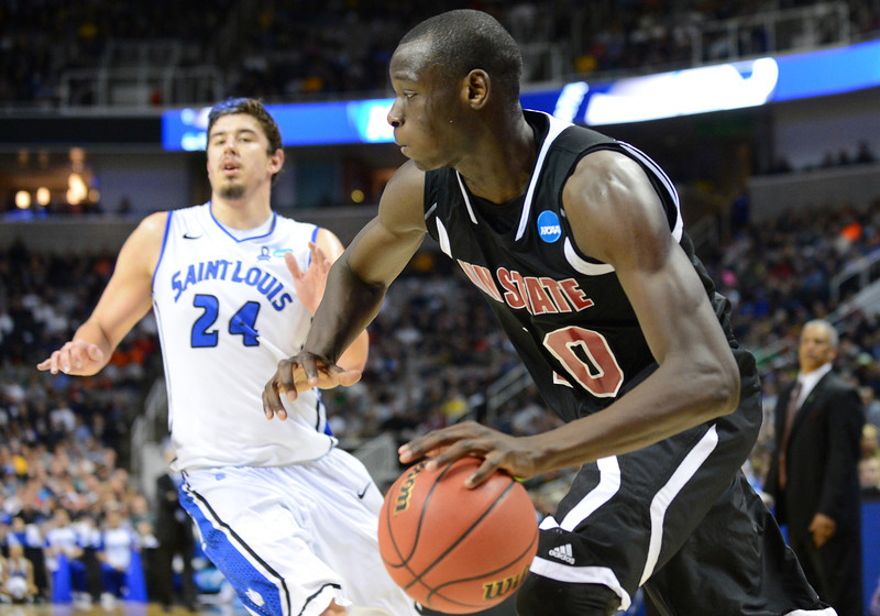 March 21, 2013: New Mexico State Aggies forward Bandja Sy (10) drives the baseline during a game between the New Mexico State Aggies and the Saint Louis Billikens in the second round of the NCAA Division I Men's Basketball Championship at HP Pavilion in San Jose, California.