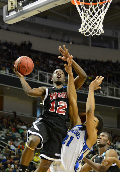 March 21, 2013: New Mexico State Aggies guard K.C. Ross-Miller (12) puts up a shot during a game between the New Mexico State Aggies and the Saint Louis Billikens in the second round of the NCAA Division I Men's Basketball Championship at HP Pavilion in San Jose, California.