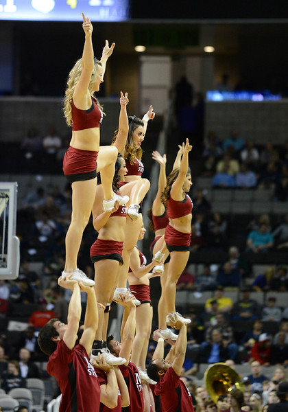 March 21, 2013: New Mexico State Aggies cheerleaders perform in a timeout during a game between the New Mexico State Aggies and the Saint Louis Billikens in the second round of the NCAA Division I Men's Basketball Championship at HP Pavilion in San Jose, California.