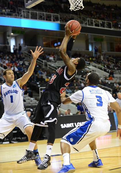 March 21, 2013: New Mexico State Aggies guard Daniel Mullings (23) puts up a shot during a game between the New Mexico State Aggies and the Saint Louis Billikens in the second round of the NCAA Division I Men's Basketball Championship at HP Pavilion in San Jose, California.