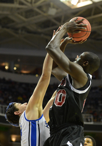March 21, 2013: New Mexico State Aggies forward Bandja Sy (10) puts up a contested shot during a game between the New Mexico State Aggies and the Saint Louis Billikens in the second round of the NCAA Division I Men's Basketball Championship at HP Pavilion in San Jose, California.