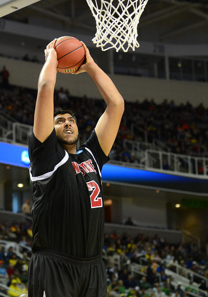 March 21, 2013: New Mexico State Aggies center Sim Bhullar (2) goes up for a dunk during a game between the New Mexico State Aggies and the Saint Louis Billikens in the second round of the NCAA Division I Men's Basketball Championship at HP Pavilion in San Jose, California.