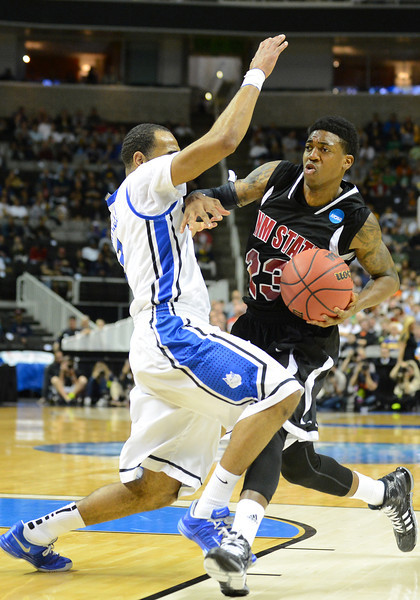 March 21, 2013: New Mexico State Aggies guard Daniel Mullings (23) tries to drive past Saint Louis Billikens guard Kwamain Mitchell (3) during a game between the New Mexico State Aggies and the Saint Louis Billikens in the second round of the NCAA Division I Men's Basketball Championship at HP Pavilion in San Jose, California.
