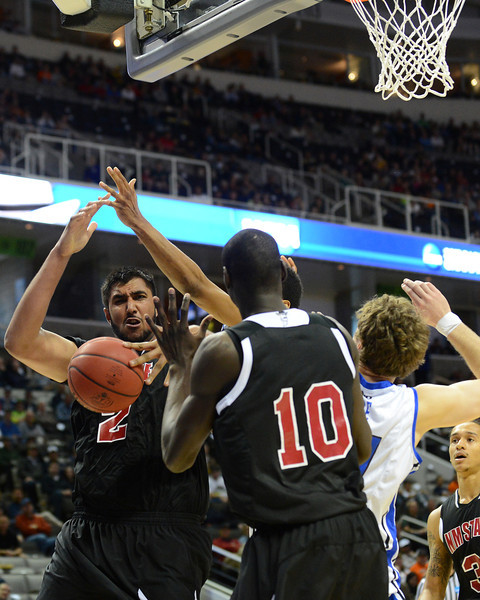 March 21, 2013: New Mexico State Aggies center Sim Bhullar (2) battles for a loose ball during a game between the New Mexico State Aggies and the Saint Louis Billikens in the second round of the NCAA Division I Men's Basketball Championship at HP Pavilion in San Jose, California.