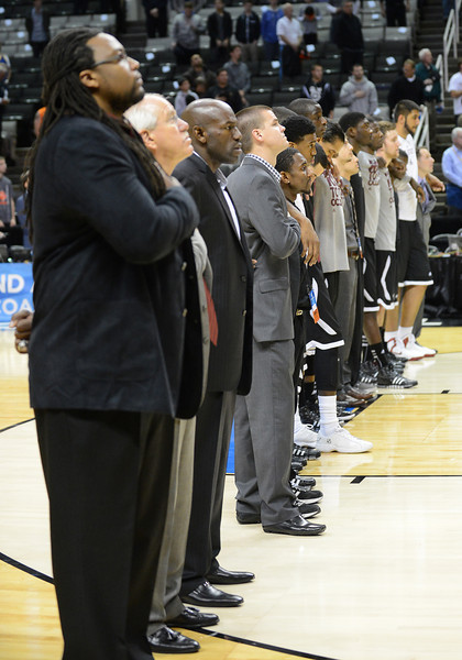 March 21, 2013: Members of the New Mexico State Aggies team stand during the national anthem prior to a game between the New Mexico State Aggies and the Saint Louis Billikens in the second round of the NCAA Division I Men's Basketball Championship at HP Pavilion in San Jose, California.