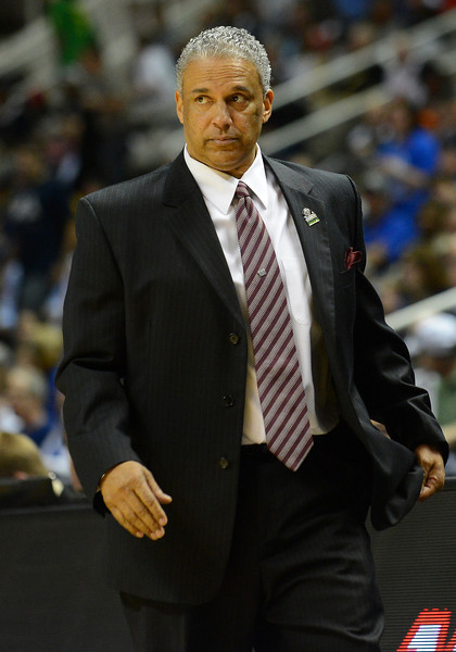March 21, 2013: New Mexico State Aggies head coach Marvin Menzies watches the action during a game between the New Mexico State Aggies and the Saint Louis Billikens in the second round of the NCAA Division I Men's Basketball Championship at HP Pavilion in San Jose, California.
