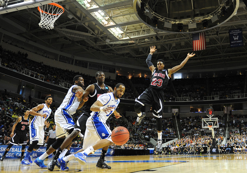 March 21, 2013: New Mexico State Aggies guard Daniel Mullings (23) loses the ball during a game between the New Mexico State Aggies and the Saint Louis Billikens in the second round of the NCAA Division I Men's Basketball Championship at HP Pavilion in San Jose, California.