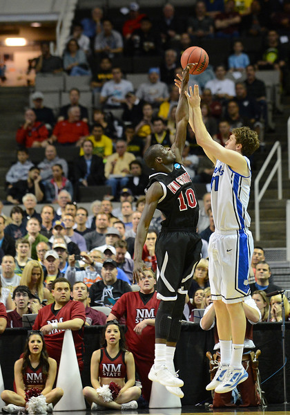 March 21, 2013: New Mexico State Aggies forward Bandja Sy (10) blocks a three point attempt during a game between the New Mexico State Aggies and the Saint Louis Billikens in the second round of the NCAA Division I Men's Basketball Championship at HP Pavilion in San Jose, California.