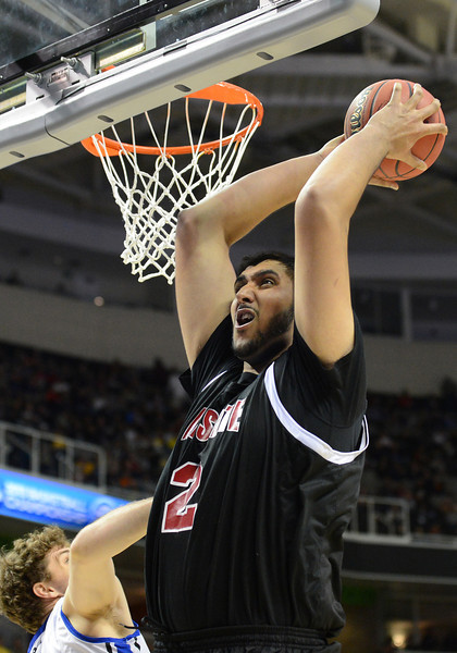 March 21, 2013: New Mexico State Aggies center Sim Bhullar (2) grabs an offensive rebound during a game between the New Mexico State Aggies and the Saint Louis Billikens in the second round of the NCAA Division I Men's Basketball Championship at HP Pavilion in San Jose, California.