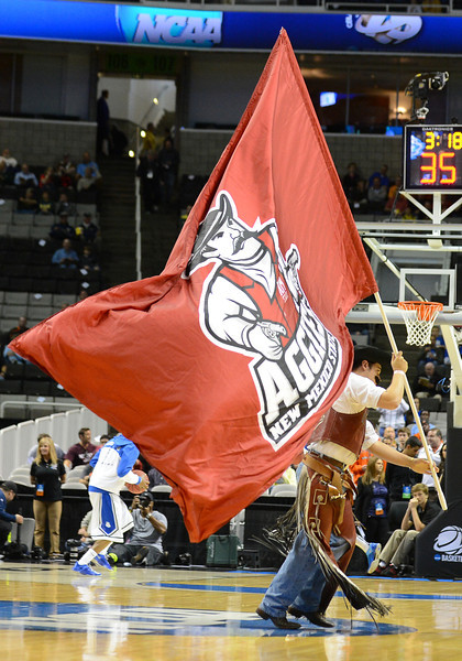 March 21, 2013: The New Mexico State Aggies mascot Pistol Pete waves his flag during a game between the New Mexico State Aggies and the Saint Louis Billikens in the second round of the NCAA Division I Men's Basketball Championship at HP Pavilion in San Jose, California.