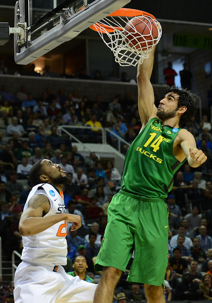 March 21, 2013: Oregon Ducks forward Arsalan Kazemi (14) dunks during a game between the Oregon Ducks and the Oklahoma State Cowboys in the second round of the NCAA Division I Men's Basketball Championship at HP Pavilion in San Jose, California.