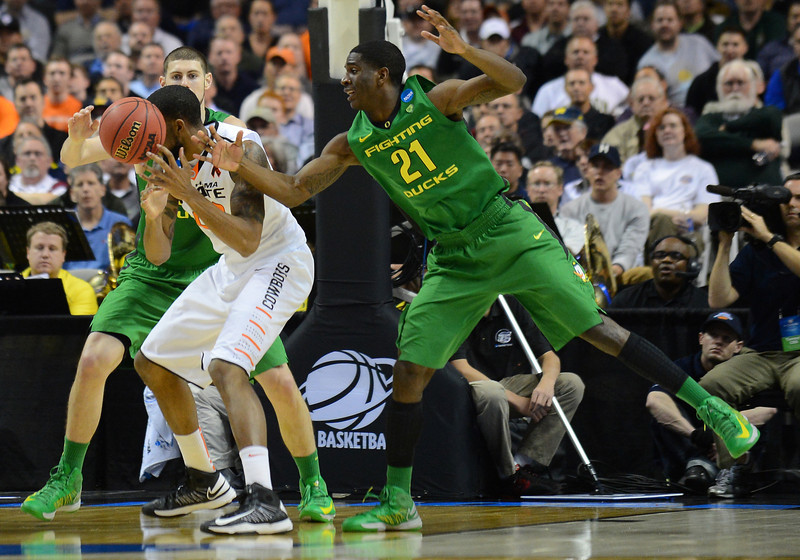 March 21, 2013: Oregon Ducks guard Damyean Dotson (21) battles for a rebound against an Oklahoma State Cowboys player during a game between the Oregon Ducks and the Oklahoma State Cowboys in the second round of the NCAA Division I Men's Basketball Championship at HP Pavilion in San Jose, California.