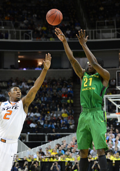 March 21, 2013: Oregon Ducks guard Damyean Dotson (21) shoots over Oklahoma State Cowboys guard/forward Le'Bryan Nash (2) during a game between the Oregon Ducks and the Oklahoma State Cowboys in the second round of the NCAA Division I Men's Basketball Championship at HP Pavilion in San Jose, California.