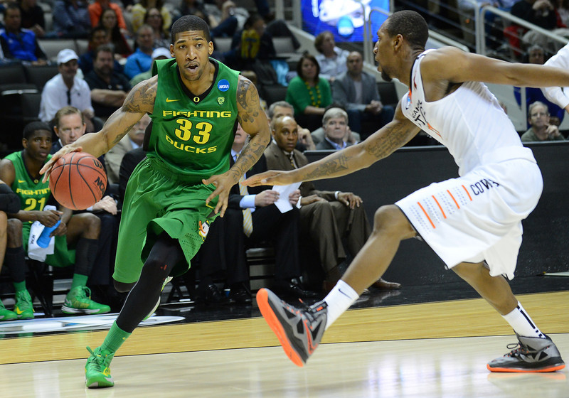 March 21, 2013: Oregon Ducks forward Carlos Emory (33) drives past an Oklahoma State Cowboys defender during a game between the Oregon Ducks and the Oklahoma State Cowboys in the second round of the NCAA Division I Men's Basketball Championship at HP Pavilion in San Jose, California.