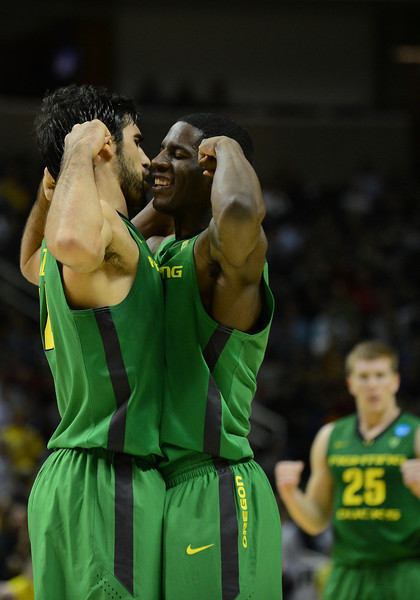 March 21, 2013: Oregon Ducks forward Arsalan Kazemi (14) and Oregon Ducks guard Damyean Dotson (21) celebrate after a dunk during a game between the Oregon Ducks and the Oklahoma State Cowboys in the second round of the NCAA Division I Men's Basketball Championship at HP Pavilion in San Jose, California.