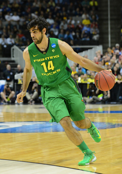 March 21, 2013: Oregon Ducks forward Arsalan Kazemi (14) dribbles the ball during a game between the Oregon Ducks and the Oklahoma State Cowboys in the second round of the NCAA Division I Men's Basketball Championship at HP Pavilion in San Jose, California.