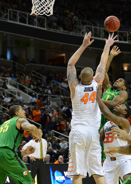 March 21, 2013: Oregon Ducks guard Dominic Artis (1) puts up a shot over the outstretched arms of Oklahoma State Cowboys center Philip Jurick (44) during a game between the Oregon Ducks and the Oklahoma State Cowboys in the second round of the NCAA Division I Men's Basketball Championship at HP Pavilion in San Jose, California.