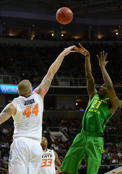 March 21, 2013: Oregon Ducks guard Damyean Dotson (21) shoots over Oklahoma State Cowboys forward Kamari Murphy (21) during a game between the Oregon Ducks and the Oklahoma State Cowboys in the second round of the NCAA Division I Men's Basketball Championship at HP Pavilion in San Jose, California.