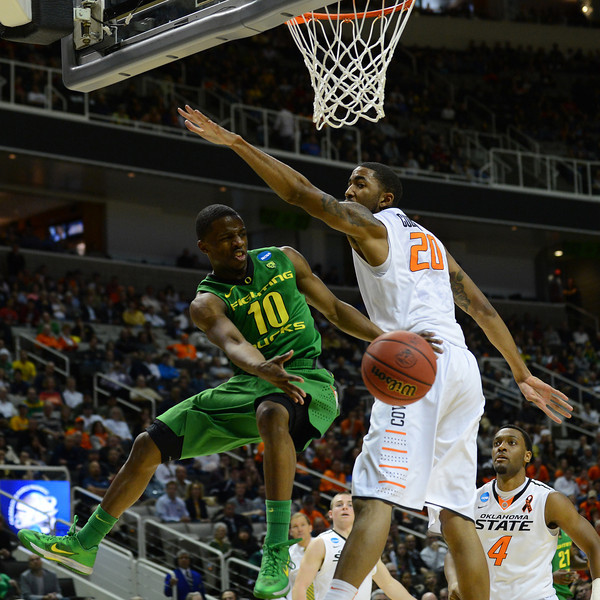 March 21, 2013: Oregon Ducks guard Johnathan Loyd (10) dishes the ball off to a teammate during a game between the Oregon Ducks and the Oklahoma State Cowboys in the second round of the NCAA Division I Men's Basketball Championship at HP Pavilion in San Jose, California.