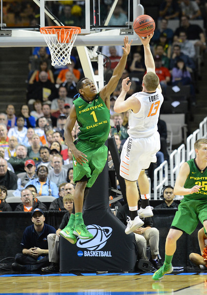 March 21, 2013: Oregon Ducks guard Dominic Artis (1) contests a shot by Oklahoma State Cowboys guard Phil Forte (13) during a game between the Oregon Ducks and the Oklahoma State Cowboys in the second round of the NCAA Division I Men's Basketball Championship at HP Pavilion in San Jose, California.