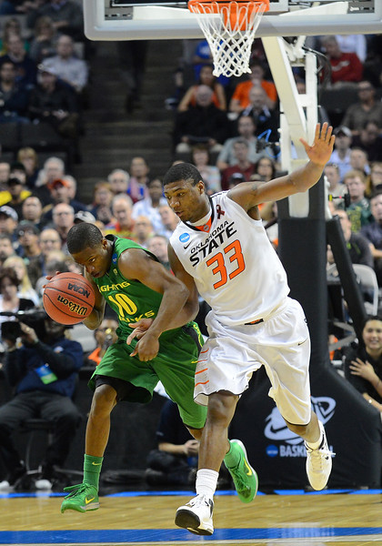 March 21, 2013: Oregon Ducks guard Johnathan Loyd (10) drives past Oklahoma State Cowboys guard Marcus Smart (33) during a game between the Oregon Ducks and the Oklahoma State Cowboys in the second round of the NCAA Division I Men's Basketball Championship at HP Pavilion in San Jose, California.