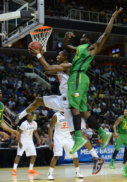 March 21, 2013: Oklahoma State Cowboys forward Kamari Murphy (21) grabs a defensive rebound during a game between the Oregon Ducks and the Oklahoma State Cowboys in the second round of the NCAA Division I Men's Basketball Championship at HP Pavilion in San Jose, California.