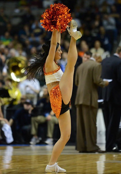 March 21, 2013: An Oklahoma State Cowboys cheerleader entertains the crowd in a timeout during a game between the Oregon Ducks and the Oklahoma State Cowboys in the second round of the NCAA Division I Men's Basketball Championship at HP Pavilion in San Jose, California.