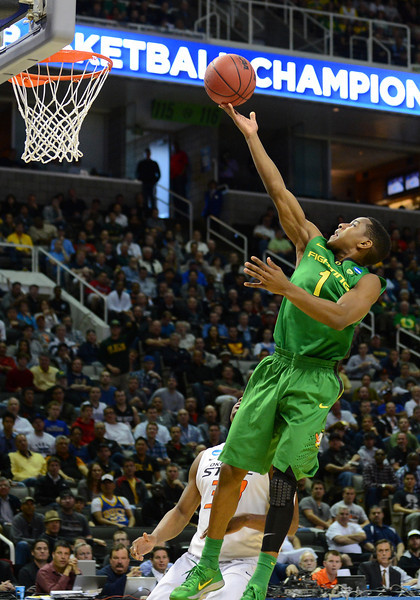 March 21, 2013: Oregon Ducks guard Dominic Artis (1) lays the ball up during a game between the Oregon Ducks and the Oklahoma State Cowboys in the second round of the NCAA Division I Men's Basketball Championship at HP Pavilion in San Jose, California.
