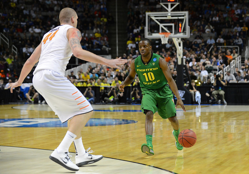 March 21, 2013: Oregon Ducks guard Johnathan Loyd (10) surveys the defense during a game between the Oregon Ducks and the Oklahoma State Cowboys in the second round of the NCAA Division I Men's Basketball Championship at HP Pavilion in San Jose, California.