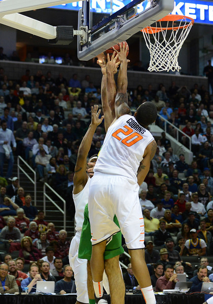 March 21, 2013: Oklahoma State Cowboys forward Michael Cobbins (20) blocks an Oregon shot during a game between the Oregon Ducks and the Oklahoma State Cowboys in the second round of the NCAA Division I Men's Basketball Championship at HP Pavilion in San Jose, California.