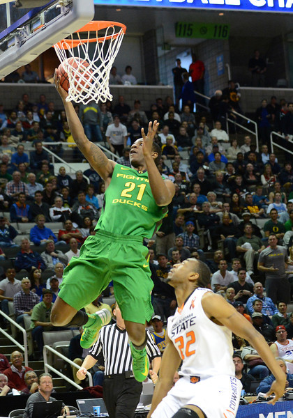 March 21, 2013: Oregon Ducks guard Damyean Dotson (21) drives in for a layup during a game between the Oregon Ducks and the Oklahoma State Cowboys in the second round of the NCAA Division I Men's Basketball Championship at HP Pavilion in San Jose, California.