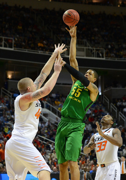 March 21, 2013: Oregon Ducks center Tony Woods (55) puts up a shot during a game between the Oregon Ducks and the Oklahoma State Cowboys in the second round of the NCAA Division I Men's Basketball Championship at HP Pavilion in San Jose, California.