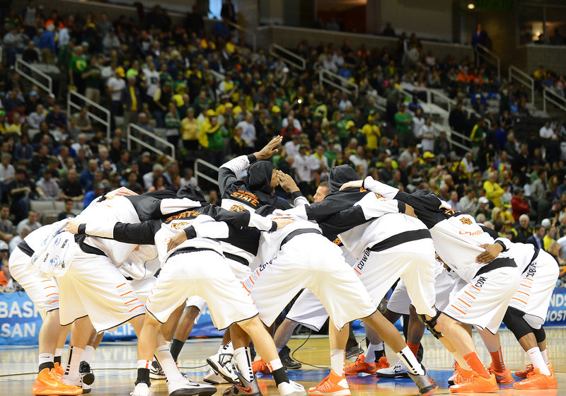 March 21, 2013: The Oklahoma State Cowboys huddle prior to tipoff of a game between the Oregon Ducks and the Oklahoma State Cowboys in the second round of the NCAA Division I Men's Basketball Championship at HP Pavilion in San Jose, California.