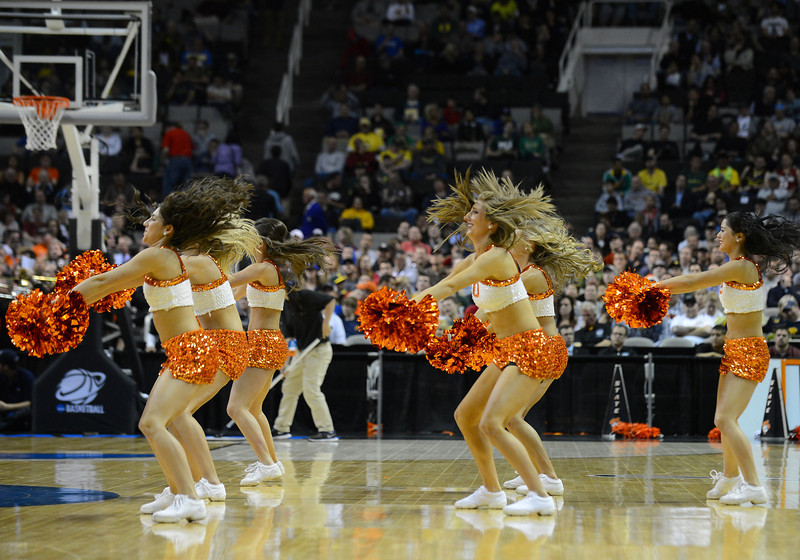 March 21, 2013: Oklahoma State Cowboys cheerleaders perform in a timeout during a game between the Oregon Ducks and the Oklahoma State Cowboys in the second round of the NCAA Division I Men's Basketball Championship at HP Pavilion in San Jose, California.
